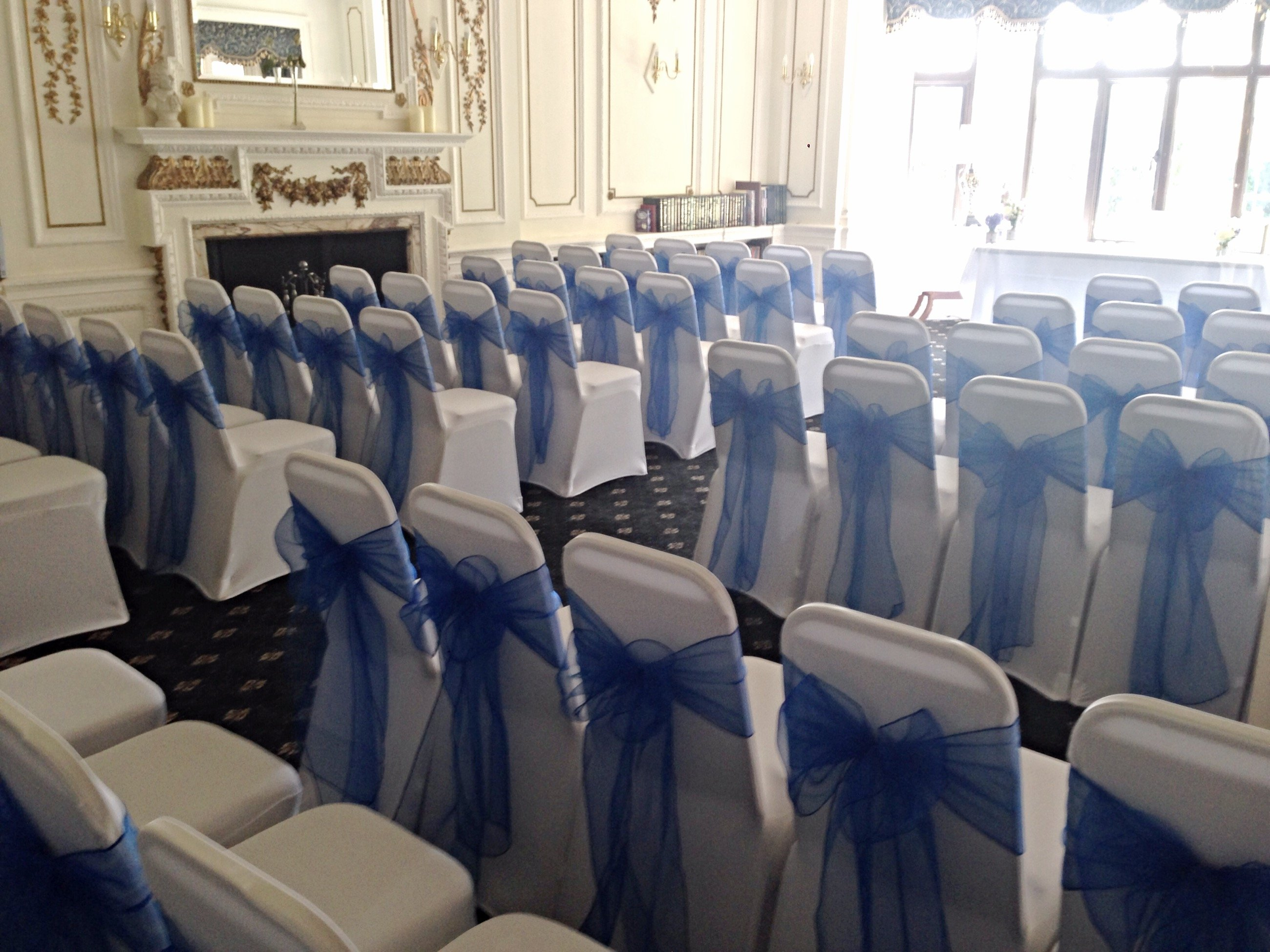 Navy Organza Sashes And White Lycra Chair Covers And De Rougement Manor